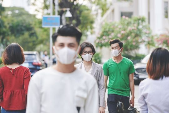 People in the street wearing face masks